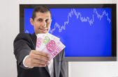 Businessman offering euro — Stock Photo