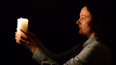 Woman in candlelight with Low Key — Стоковое видео