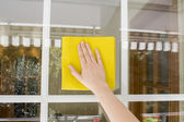 Cleaning glass outdoor — Stock Photo