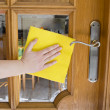 Cleaning glass door — Stock Photo