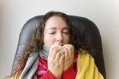 Woman sneezing — Stock Photo