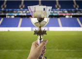 More euros more titles with the background of a stadium — Stock Photo