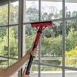 Cleaning window with machine — Stock Photo #42438373