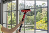 Cleaning window with machine  — Stock Photo