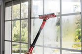 Cleaning window with steam — Stock Photo