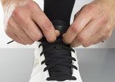 Tying shoelaces — Stock Photo