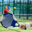 Women playing paddle tennis — Stock Photo #49404559