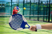 Women playing paddle tennis — Stock Photo