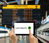 Search for last minute deals in station train — Stock Photo