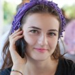 Beautiful laughing teenage girl  talking on mobile phone — Stock fotografie