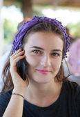 Beautiful laughing teenage girl talking on mobile phone — Stock Photo