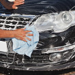 Stock Photo: Mwashing black car with cloth