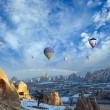Hot air balloon flying over spectacular Cappadocia — Stock Photo #34364719