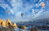 Hot air balloon flying over spectacular Cappadocia — Stock Photo