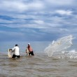 Fishermen throwing a fishnet, — Stock Photo #39560513