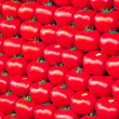 Stock Photo: Background of fresh tomatoes for sale at market