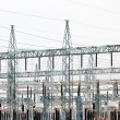 Stock Photo: High Voltage electric substation with transformers