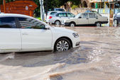 Car drives through flooded road in Mersin — Stock Photo