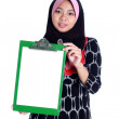 Muslim woman with white sign - Stok fotoraf