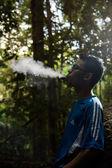 Men blowing smoke — Stock Photo