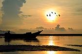 Fishing Boat at Sunrise with bird flying around — Stock Photo