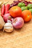 Asian ingredients food on pandanus mat — Stock Photo