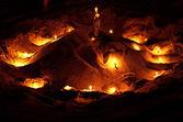 Svíčky na písku — Stock fotografie