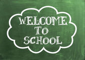 Welcome to School text on green board — Foto de Stock