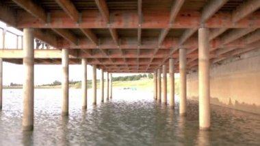 Water under the bridge — Stock Video