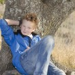 Stock Photo: Teen under tree