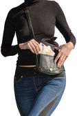 Beautiful woman pulls out bundle of euro banknotes from handbag isolated — Stock Photo