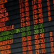 Stock Photo: Departures and arrivals electronic schedule