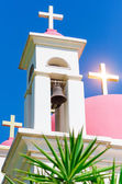 Sunshine ray reflection in golden crosses on pink domes — Stock Photo