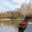Boat near the pier on springtime canal — Stock Photo