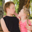 Two friends boy and girl hugging in park — Stock Photo