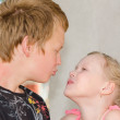 First love: two kissing kids — Stock Photo