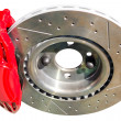Assembled auto disc brakes red caliper with pads — Stock Photo #40903983