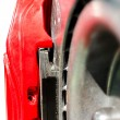 Stock Photo: Closeup pads on disc car brake in red caliper