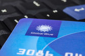 "Plastic ""Global Blue"" card on laptop ThinkPad keyboard — Foto Stock"