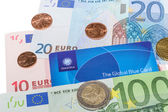 Global Blue Tax Free card against Euro notes and Cent coins — Stock Photo