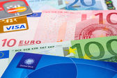 Global Blue, Visa and MasterCard credit cards on Euro banknotes — Stock Photo