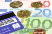 Barcode and logo on Global Blue card against European currency — Stock Photo