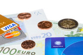 Credit and Tax Free cards on Euro banknotes with coins — Stock Photo