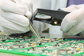Quality control of electronic components on PCB — Stock Photo