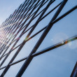 Glass and steel - mirrored facade of modern office building — Stock Photo