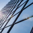 Glass and steel - mirrored facade of modern office building — Stock Photo #45598903