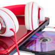 Red headphones and laptop with compact disk — Stock Photo #45872705
