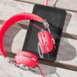 Red colored headphones and tablet PC — Stock Photo #48214603