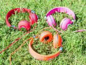 Set of three varicolored colorful headphones  — Stock Photo