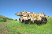 Destroyed rusty Centurion Shot Kal tank — Photo